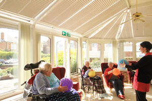 Home of Comfort - Activity session in the conservatory